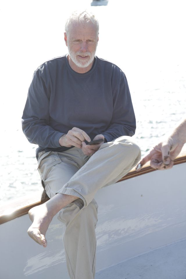 Dennis calculating anchor rode length on a cellphone